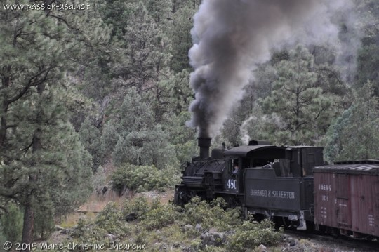 Steam engine and black smoke plume